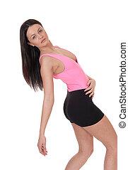 Lovely woman in shorts bending backwards