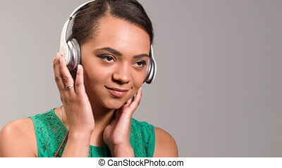 lovely woman listening her favorite song - portrait of a...