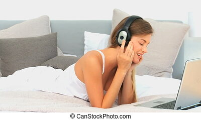 Lovely woman listening to music in