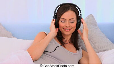 Lovely woman listening to some musi