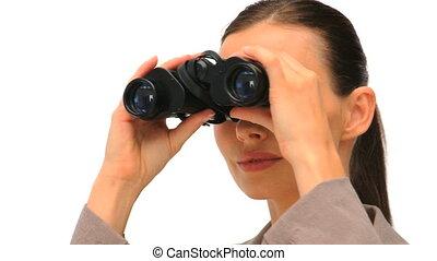 Lovely woman looking through binoculars