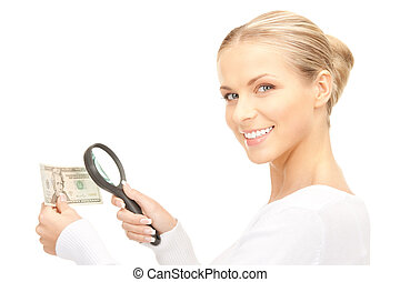 woman with magnifying glass and money