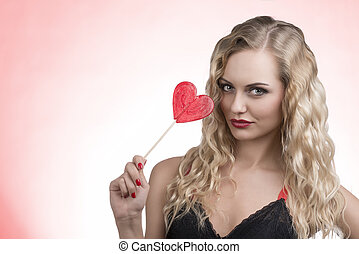 lovely woman with red lollipop