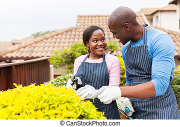 young african american couple gardening together