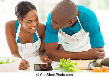 young african american couple searching for a recipe