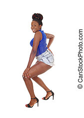 Lovely young African woman standing in shorts
