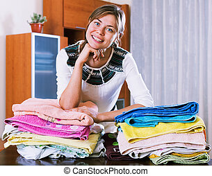 Lovely young beautiful woman with colorful towels