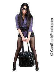 Lovely young brunette with a black handbag. Isolated