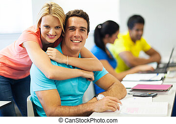 young college couple in lecture room