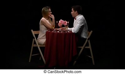 Lovely young couple having romantic evening. Slow motion