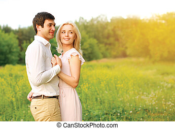 Lovely young couple in love outdoors in summer day