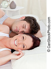 Lovely young couple resting in bed