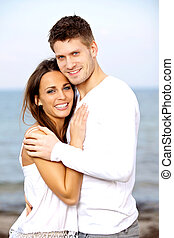Lovely Young Couple Smiling while Posing - Portrait of a...