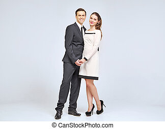 Lovely young couple wearing evening clothes