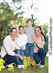 family of four portrait outdoors