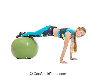 Lovely young girl exercising on fitness ball