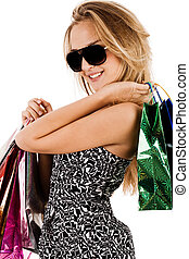Lovely young model with shopping bags
