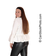 Lovely young teenage girl standing from back, smiling