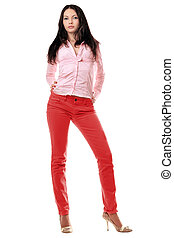 Lovely young woman in red jeans