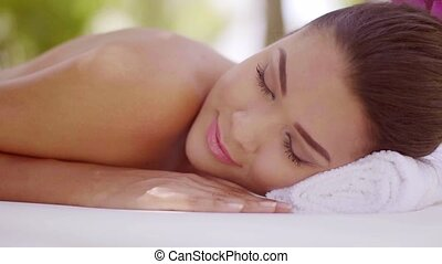 Lovely young woman relaxing at a spa