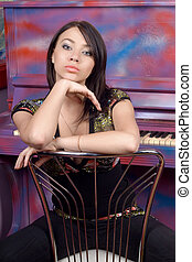 Lovely young woman sitting on a chair