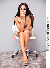 Lovely young woman sitting on chair