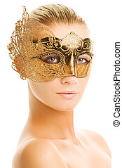 Lovely young woman with carnival mask on her face