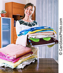 Lovely young woman with colorful towels