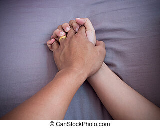 Lover hands on bed - Two hands of lover clasp on bed