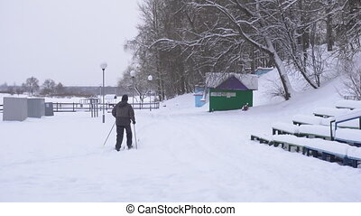 Lover man skiing in park in winter, amateur - Lover man...