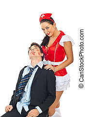 Lover man with naughty nurse - Kissed lover man sitting on a...