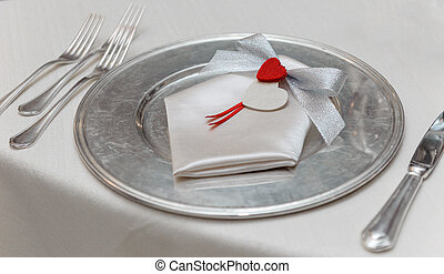 Lover place setting on white tablecloth