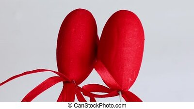 lovers' day. Valentine's Day. two red hearts on a white isolated background