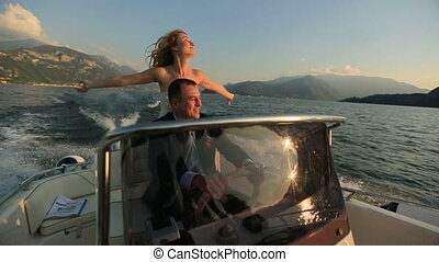 Lovers Driving the Boat on the Lake Como