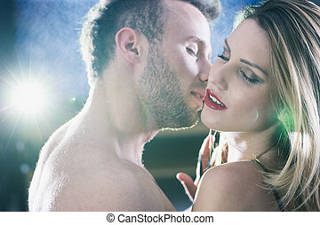 Lovers during passionate erotic foreplay