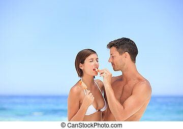 Lovers eating an ice cream