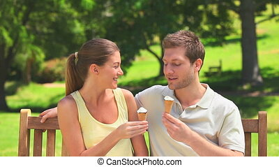 Lovers enjoying ice creams