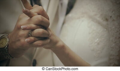 lovers holding hands tightly
