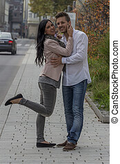 lovers in the urban environment - a couple is having fun in...