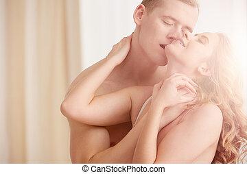 Lovers kissing in morning light