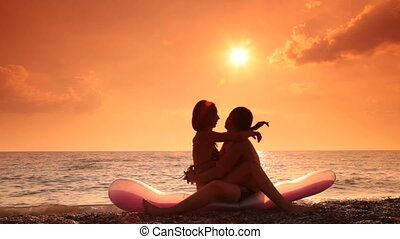 Lovers kissing on the beach