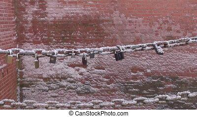 lovers lock on metal bridge chain in winter