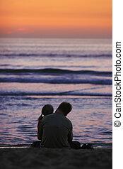 lovers on beach in sunset light