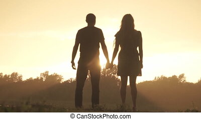 Lovers rejoice rain at sunset