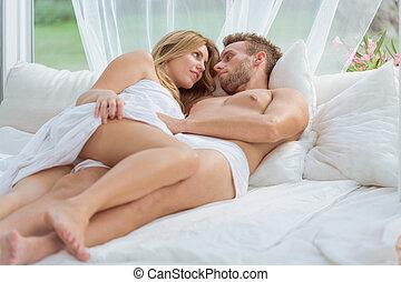 Lovers relaxing in luxury hotel