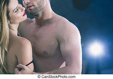 Lovers' sexual games in bedroom