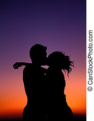 Lovers Silhouettes - Night Kiss - Colored Background...