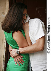 Lovers - Attractive brunette in embraces of the man