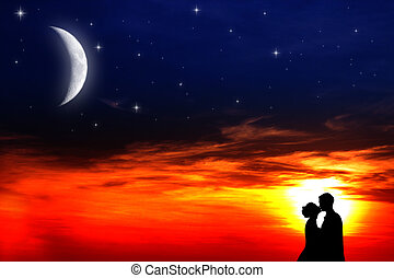 Lovers sunset - Two young lovers kissing at sunset