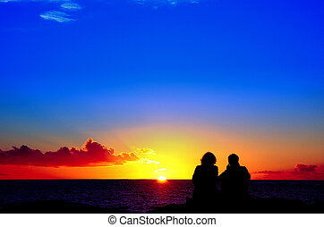 lovers to the sunset - lovers\\\' couple to the edge sea...